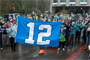 Patients, families and staff gathered together at the hospital main campus today to raise the 12th Man flag and cheer on the Seattle Seahawks.