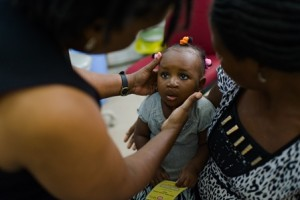 A patient is examined during a check-up at the Cleft Clinic at Komfo Anokye Teaching Hospital (KATH) in Kumasi, Ghana.