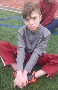 Christian smiling at soccer practice right before his birthday.
