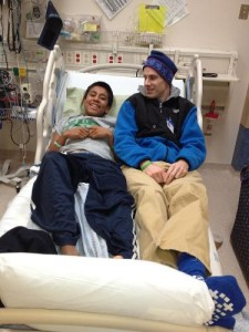 Jack sits with his uncle who donated his kidney to him.