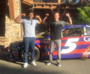 Russell Wilson and Kasey Kahne pose with the Hendrick Motorsports No. 5 Great Clips Chevrolet SS at the 2016 DRIVE Event at Suncadia Resort in Cle Elum, Wash.