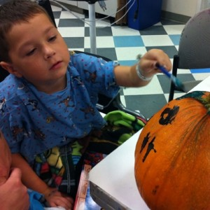 Kid Painting Pumpkin