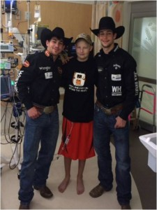 Austin Dunlap, middle, with professional bull riders Chase Outlaw, left, and Ty Pozzobon, right.