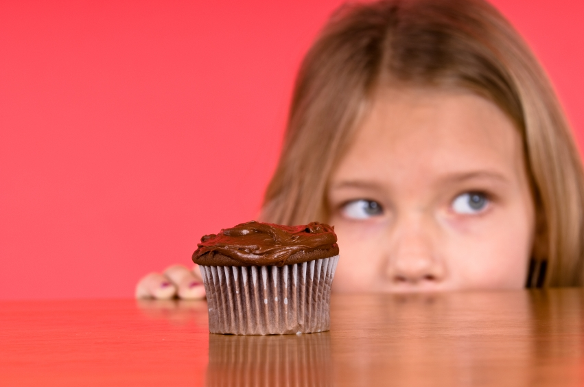 Young girl and cupcake